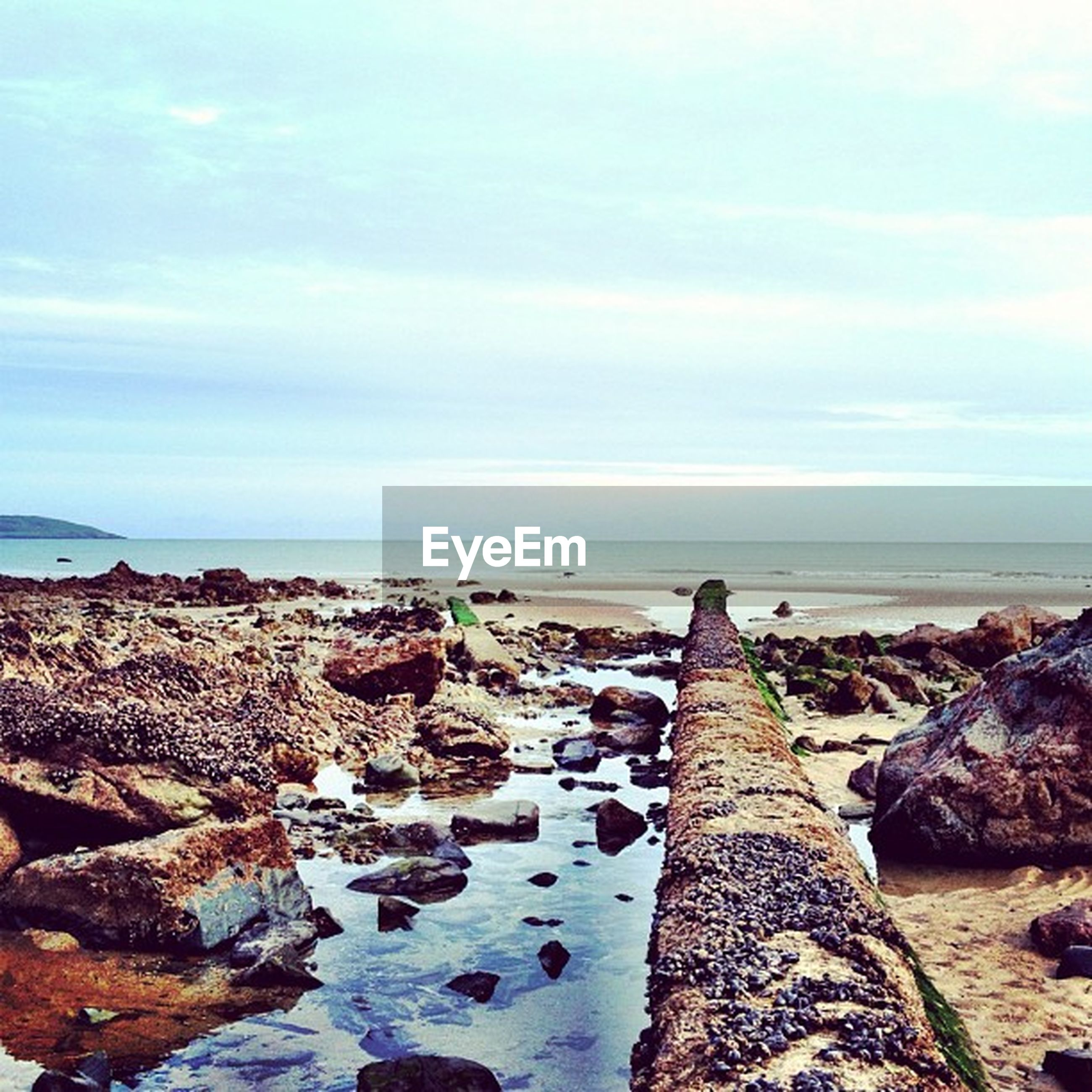 sea, horizon over water, water, sky, scenics, tranquil scene, beach, tranquility, rock - object, beauty in nature, shore, nature, cloud - sky, idyllic, cloud, rock formation, rock, outdoors, coastline, stone - object