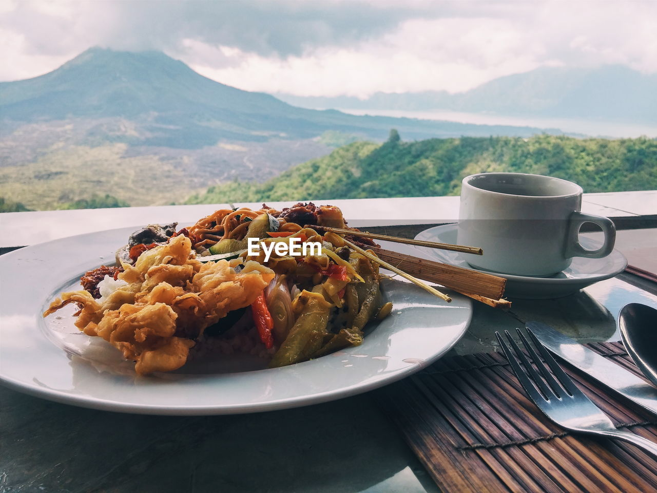 Close-Up Of Food And Coffee On Table Against Mountain