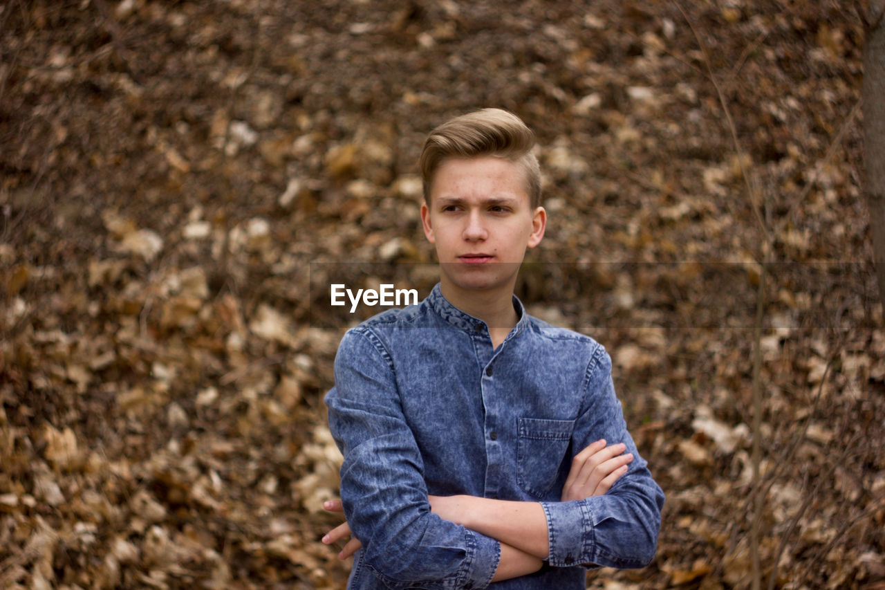 looking at camera, portrait, one person, young adult, blond hair, confidence, standing, teenager, arms crossed, teenagers only, casual clothing, people, outdoors, day, attitude, handsome, adult, nature