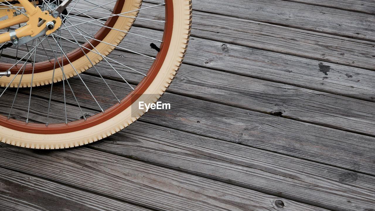 Close-Up Of Wheels Against Floorboard