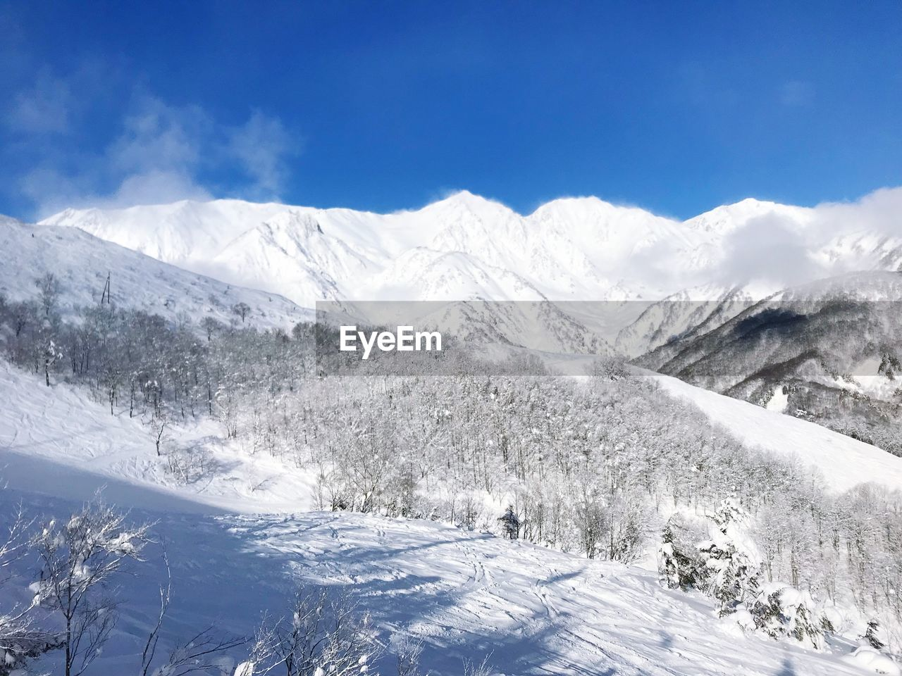 snow, mountain, nature, winter, beauty in nature, outdoors, scenics, landscape, white color, day, cold temperature, tranquil scene, no people, tranquility, sky, blue, tree, range