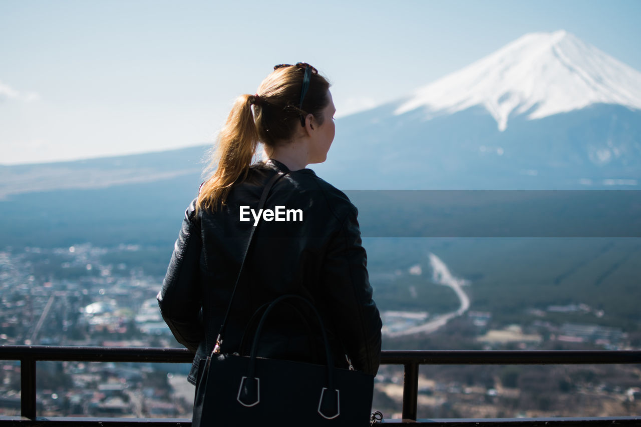 Rear view of woman looking at mt fuji terrace