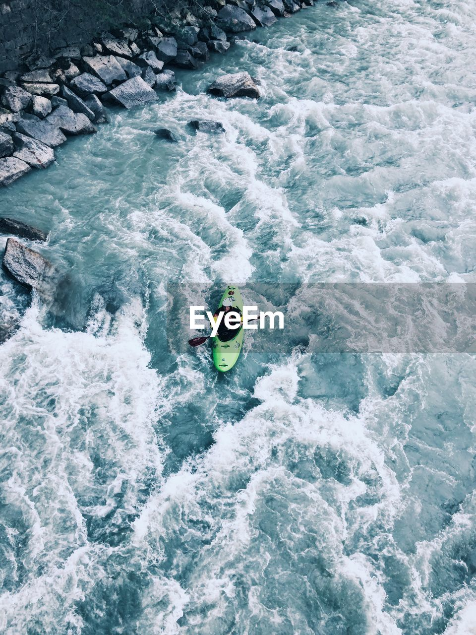 High angle view of man kayaking in river