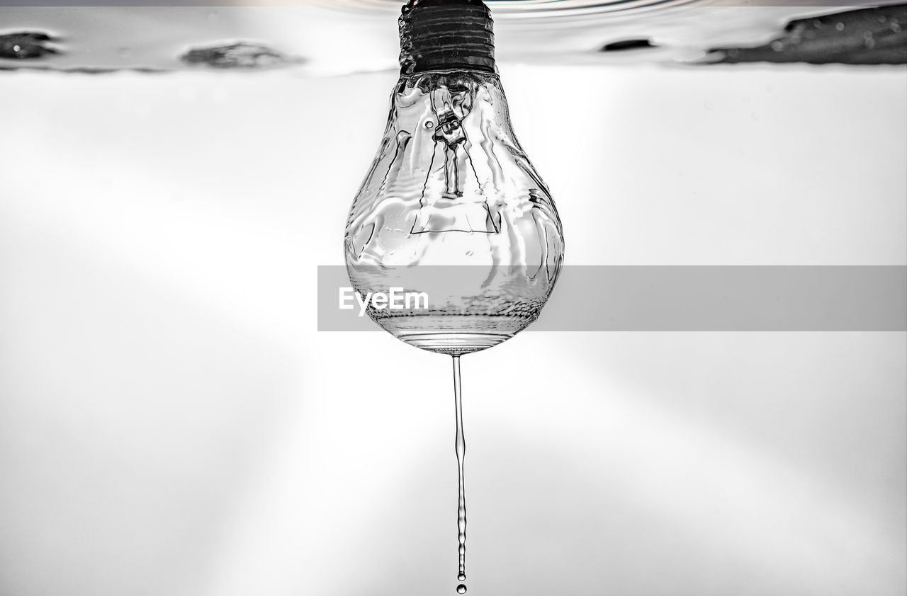 focus on foreground, transparent, close-up, glass - material, motion, water, nature, no people, day, outdoors, wineglass, glass, reflection, pouring, single object, hanging, purity