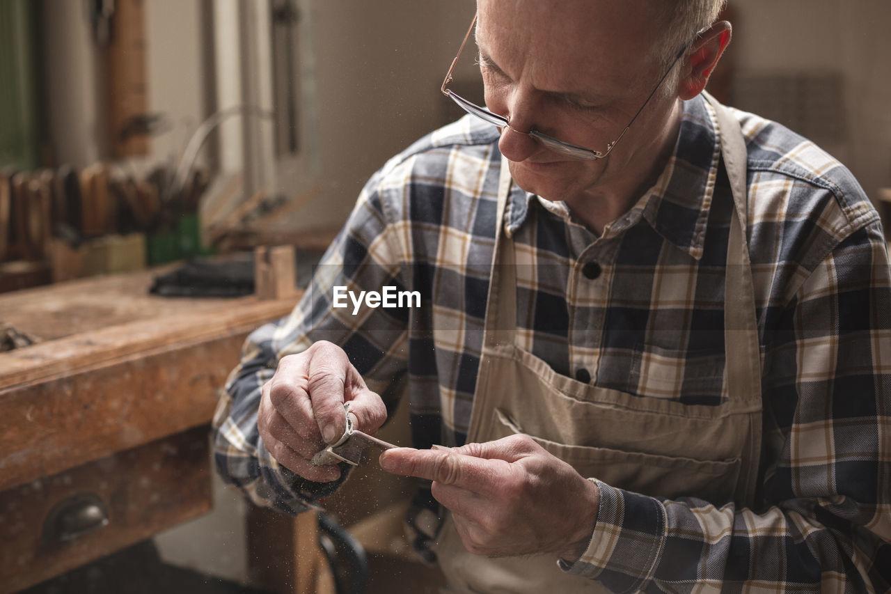Mature man working in workshop