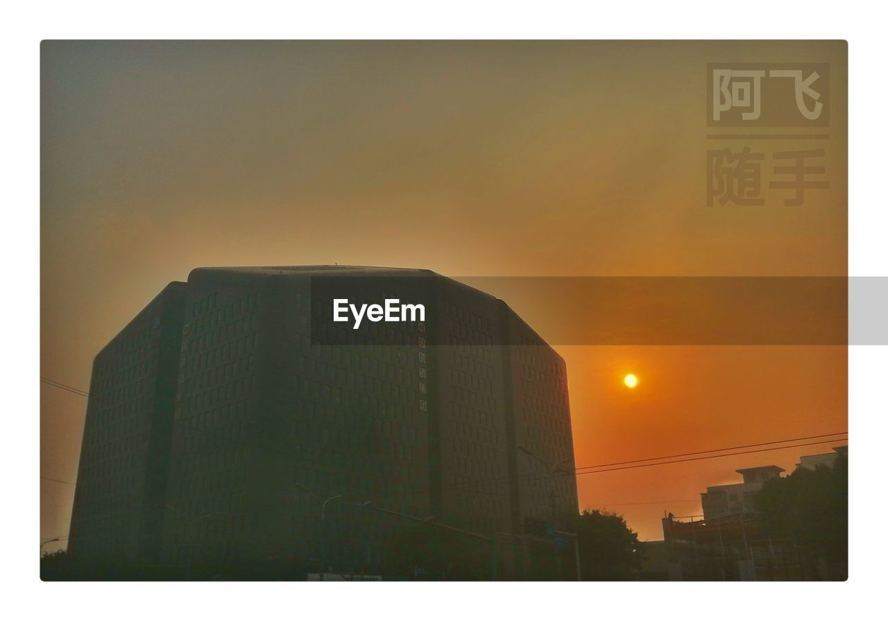architecture, building exterior, built structure, city, sunset, sky, auto post production filter, transfer print, building, no people, nature, outdoors, orange color, sun, text, communication, low angle view, office building exterior, skyscraper, sunlight