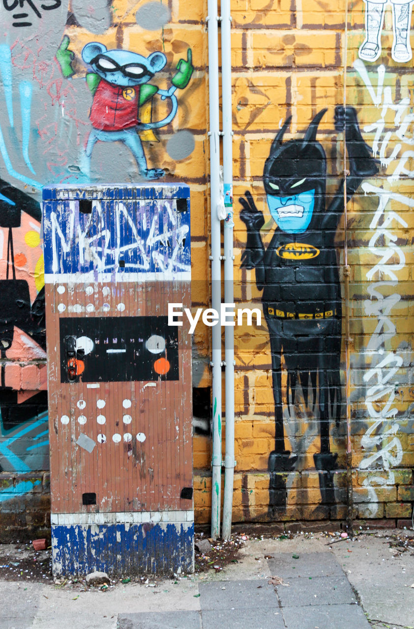 graffiti, architecture, creativity, day, no people, multi colored, art and craft, building exterior, built structure, male likeness, wall - building feature, human representation, city, wood - material, representation, outdoors, poster, messy, building, mural