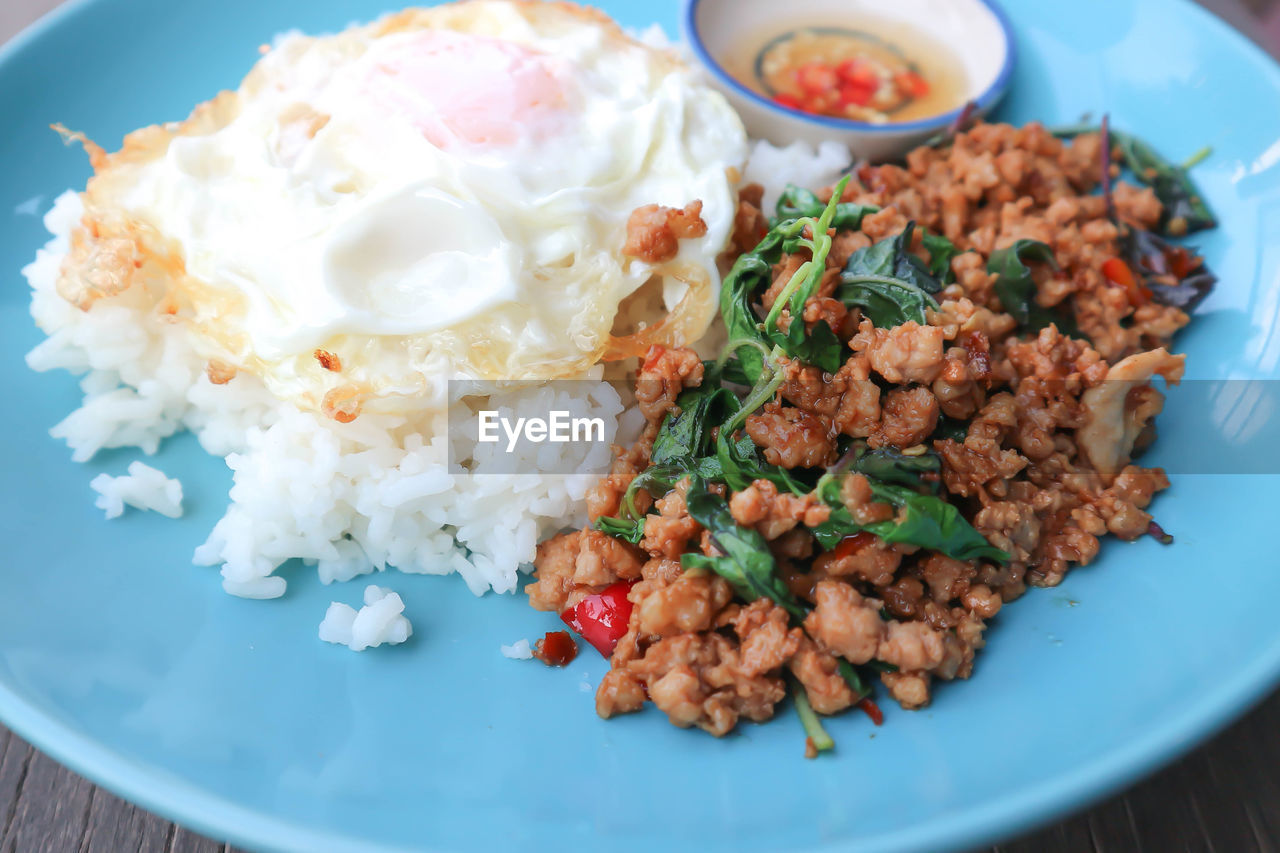 food, food and drink, ready-to-eat, freshness, plate, healthy eating, rice - food staple, serving size, meal, wellbeing, indoors, table, egg, still life, no people, close-up, rice, indulgence, vegetable, high angle view, temptation, garnish, breakfast, crockery, dinner