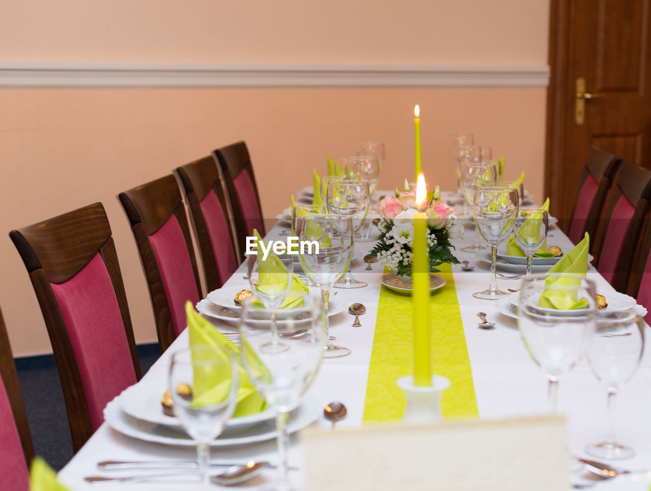 table, place setting, candle, wedding, dining table, plate, fork, napkin, celebration, chair, drinking glass, arrangement, table knife, indoors, food and drink, tablecloth, silverware, no people, flower, restaurant, neat, celebration event, dinner, food, luxury, food and drink industry, wedding ceremony, wineglass, dining room, centerpiece, life events, wedding cake, party - social event, buffet, close-up, freshness, day