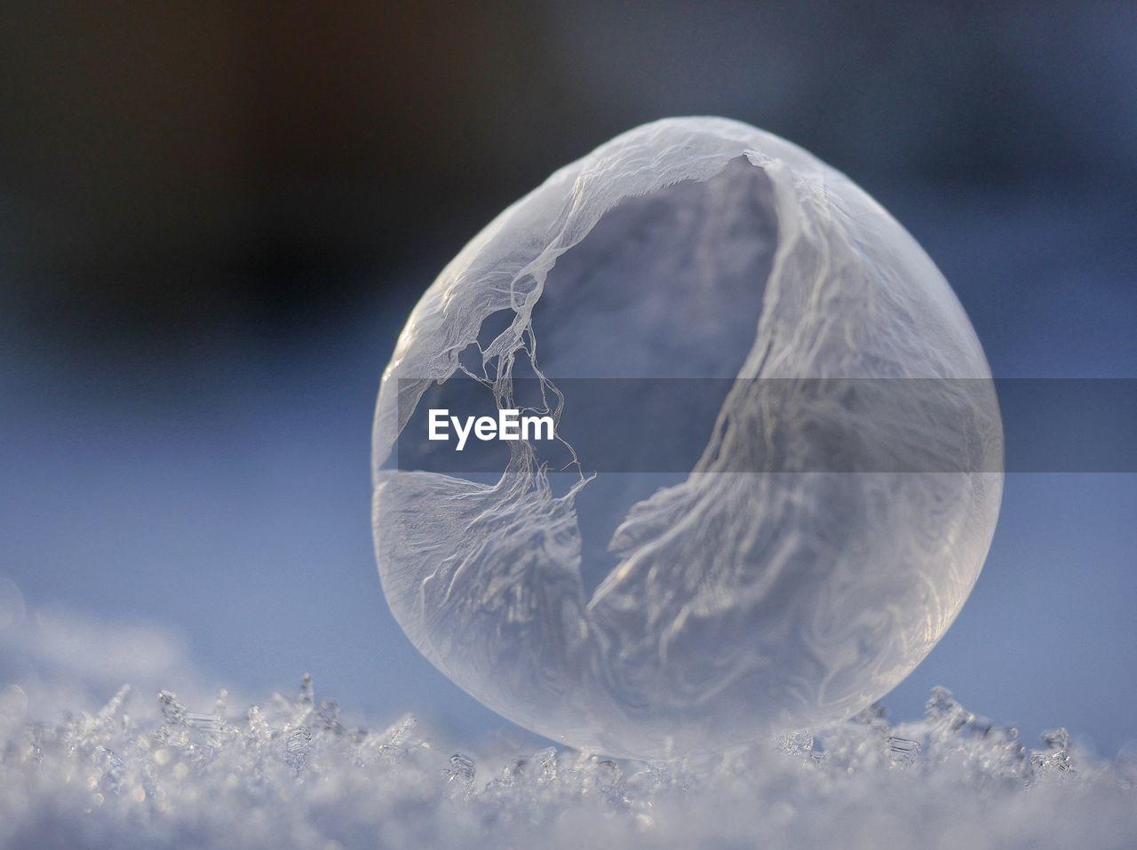 Macro Shot Of Soap Bubble On Ice