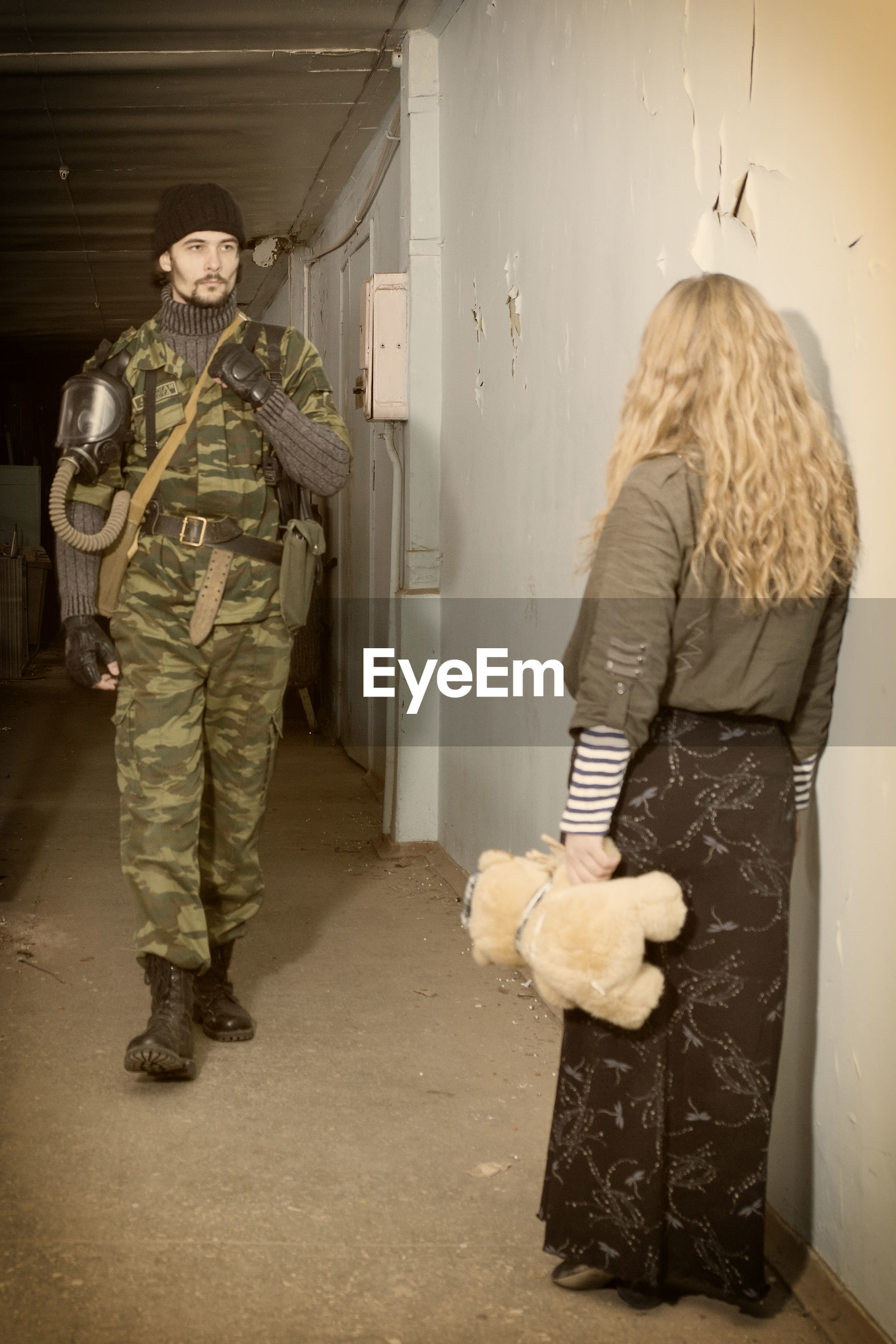 Army soldier with civilian in abandoned house
