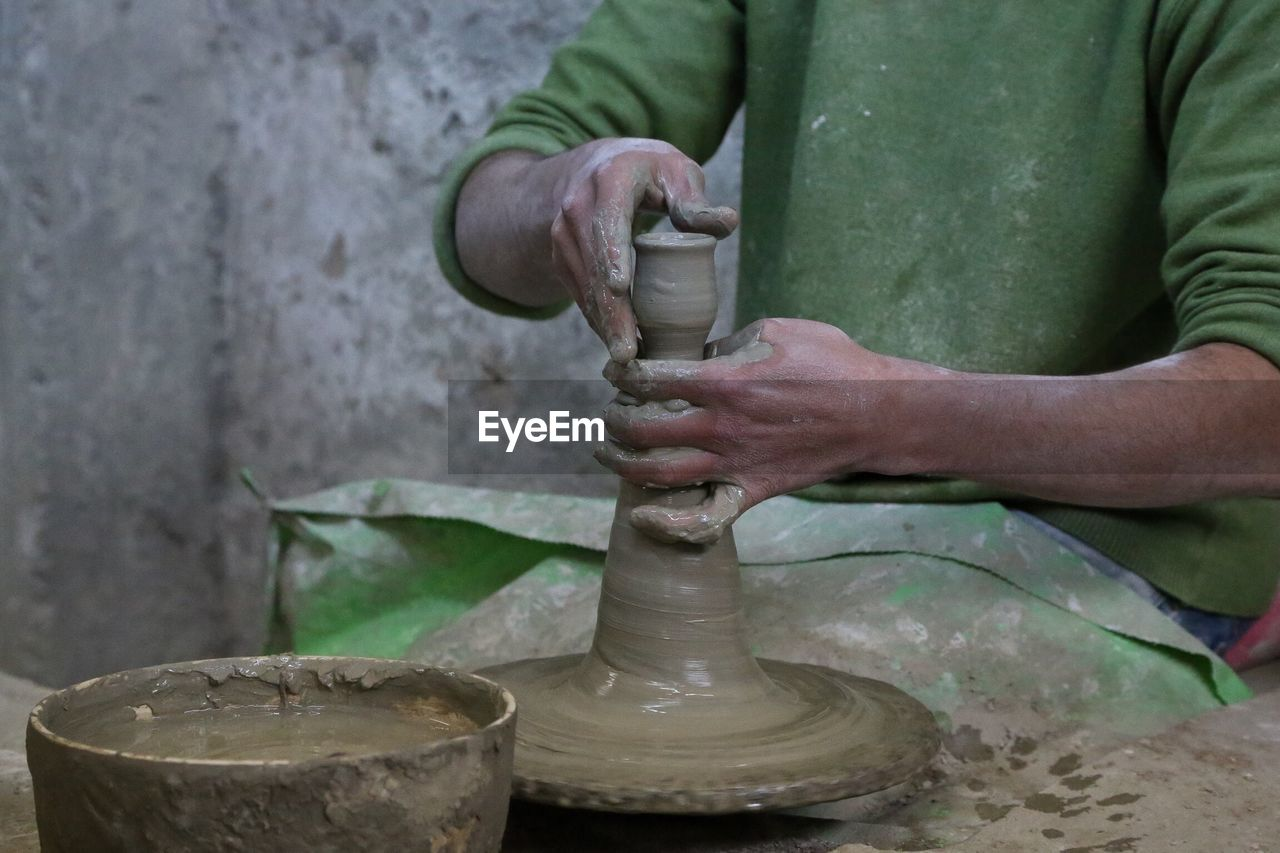 Man Shaping Pottery