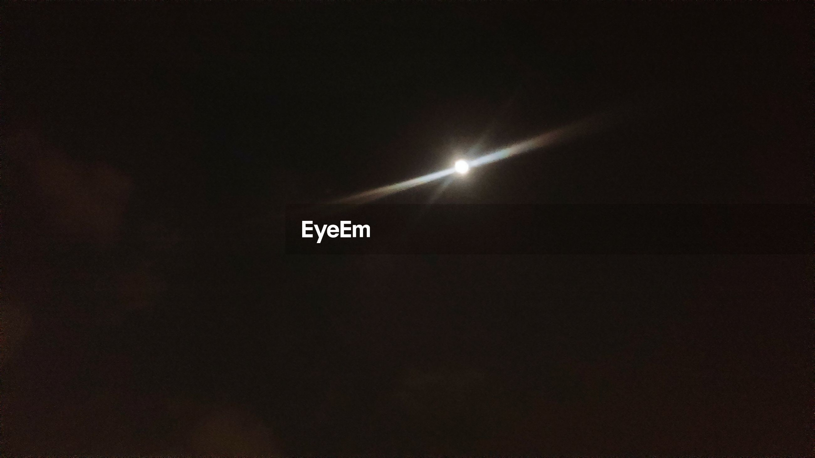 night, low angle view, copy space, moon, sky, scenics, beauty in nature, dark, tranquility, illuminated, tranquil scene, nature, clear sky, silhouette, outdoors, idyllic, no people, glowing, light - natural phenomenon, street light