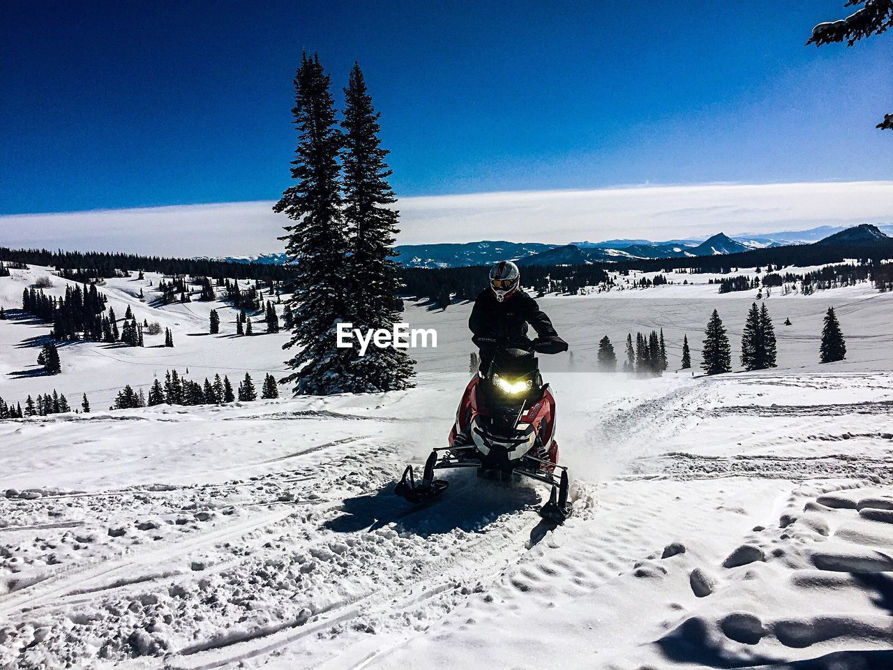 snow, cold temperature, winter, mountain, sky, covering, tree, beauty in nature, nature, real people, scenics - nature, plant, white color, mountain range, day, sport, winter sport, sunlight, leisure activity, snowcapped mountain, warm clothing, outdoors