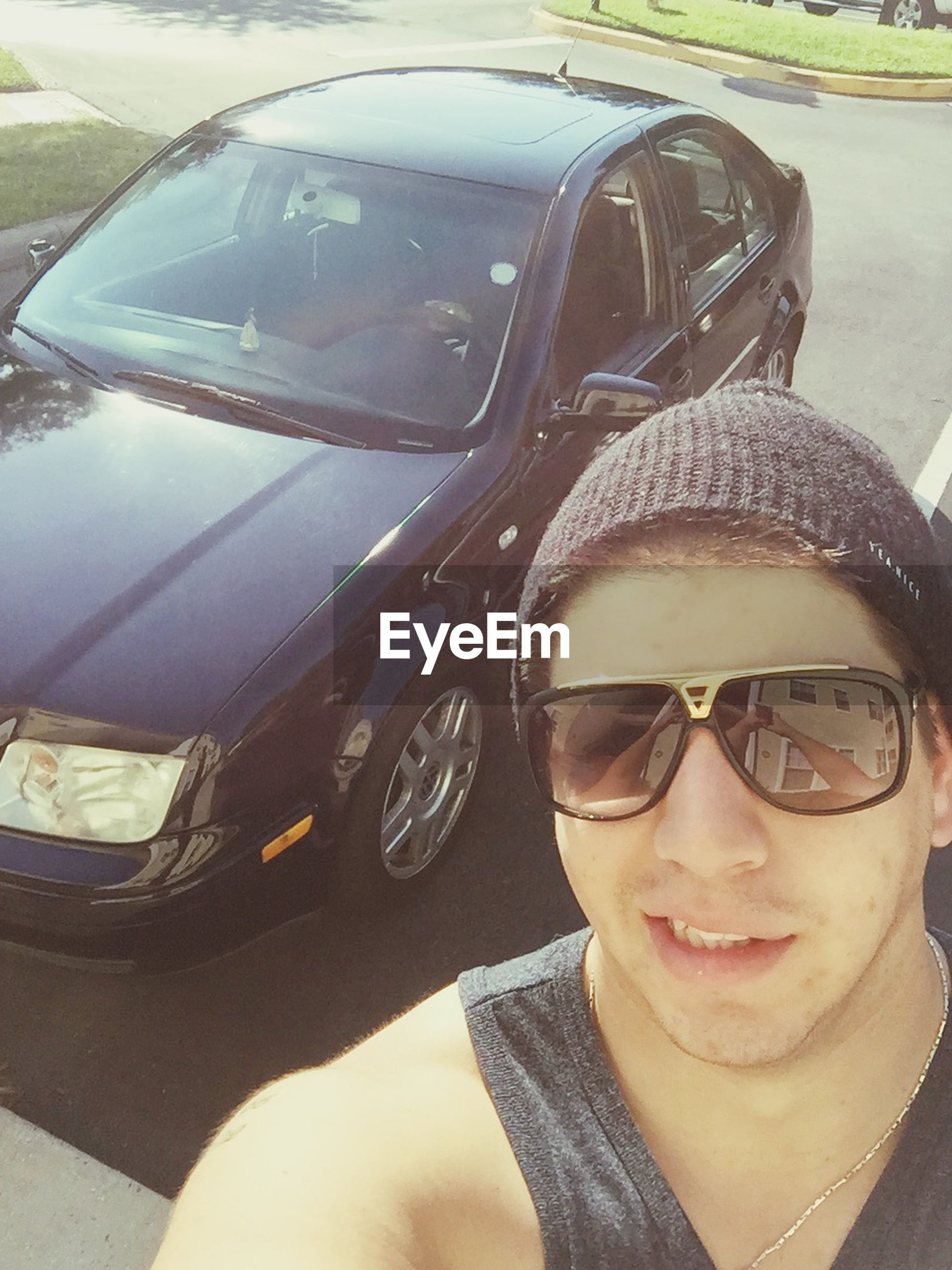 transportation, sunglasses, mode of transport, lifestyles, leisure activity, portrait, looking at camera, land vehicle, car, headshot, person, young adult, front view, reflection, travel, young men, close-up, head and shoulders