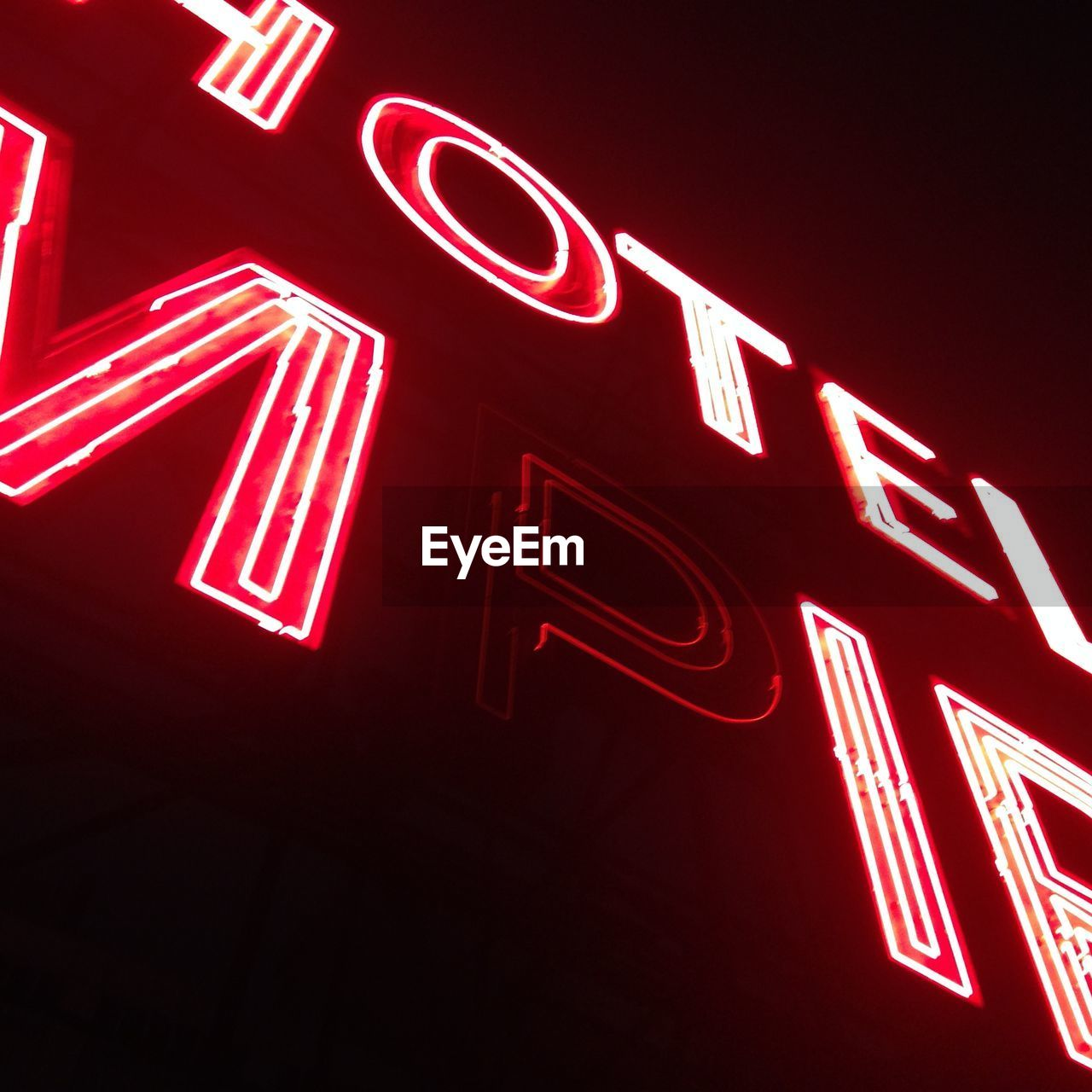 Low angle view of illuminated neon sign