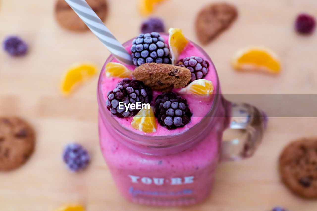 food and drink, food, freshness, table, indoors, healthy eating, focus on foreground, still life, berry fruit, close-up, spoon, wellbeing, eating utensil, high angle view, sweet food, ready-to-eat, blueberry, indulgence, no people, fruit, temptation, breakfast, glass, yogurt, purple