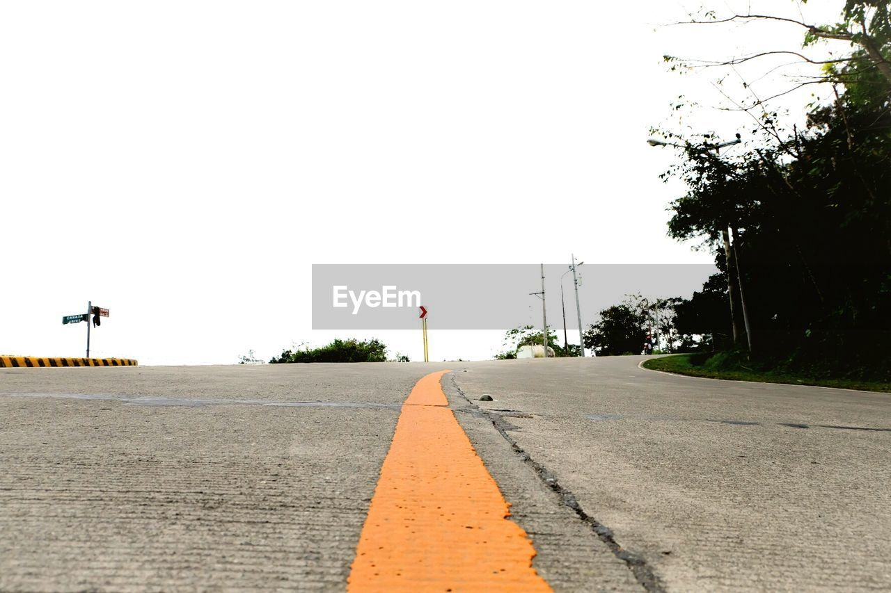 road, sky, tree, transportation, plant, sign, street, direction, the way forward, symbol, nature, clear sky, road marking, marking, day, no people, city, cone, copy space, asphalt, diminishing perspective, outdoors, dividing line, surface level
