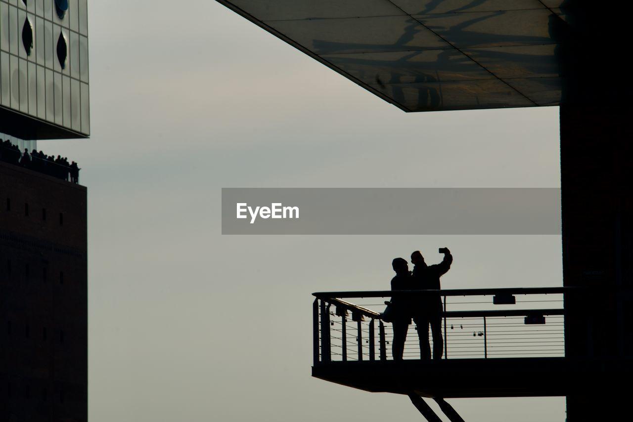 Silhouette People Taking Selfie At Elbphilharmonie