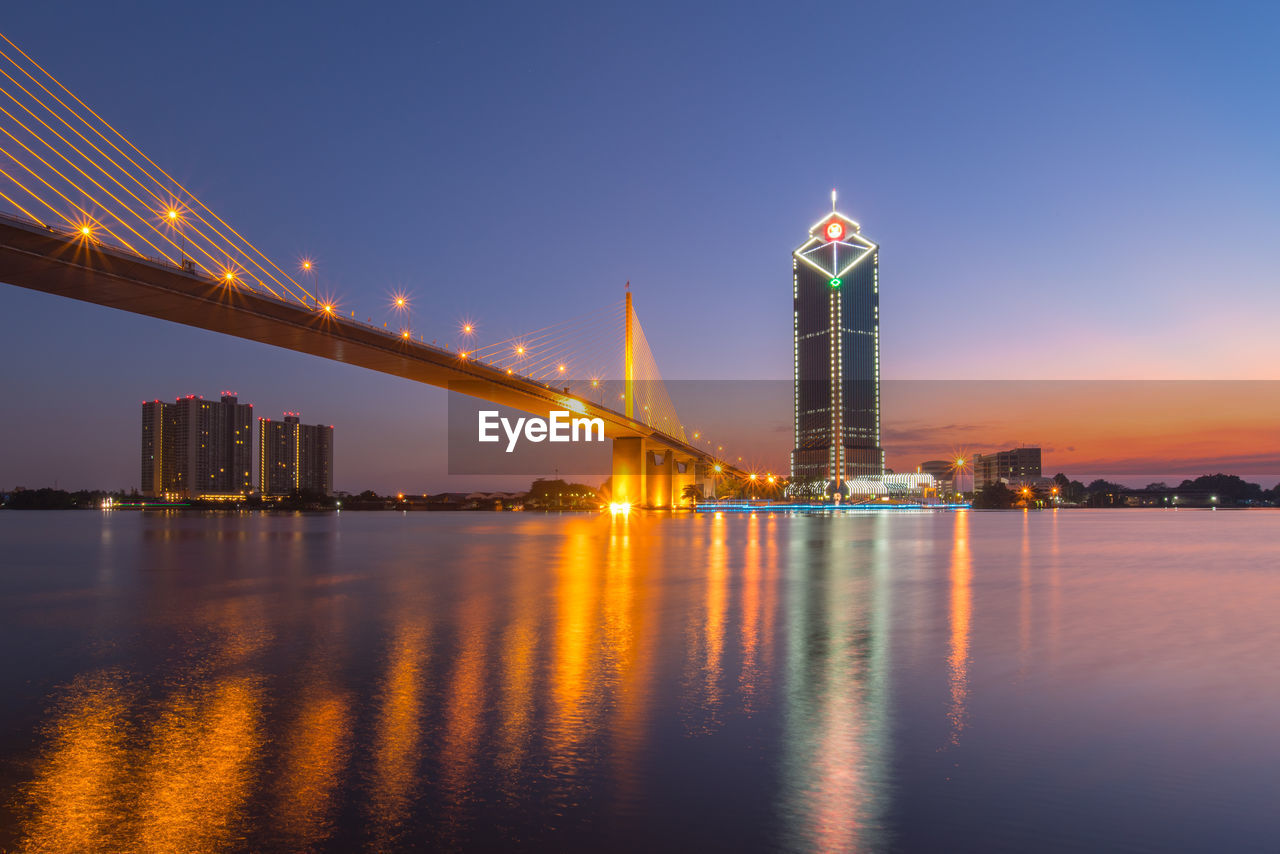 illuminated, architecture, built structure, water, building exterior, sky, reflection, night, city, waterfront, tall - high, bridge, travel destinations, river, building, bridge - man made structure, nature, office building exterior, no people, skyscraper, outdoors, cityscape, financial district, bay