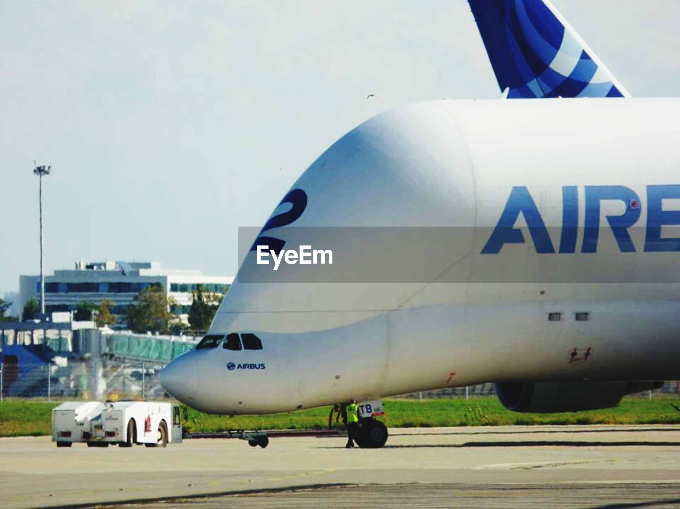 transportation, mode of transport, airplane, air vehicle, public transportation, travel, land vehicle, flying, airport runway, journey, car, on the move, sky, mid-air, airport, aircraft wing, road marking, aircraft, road, part of
