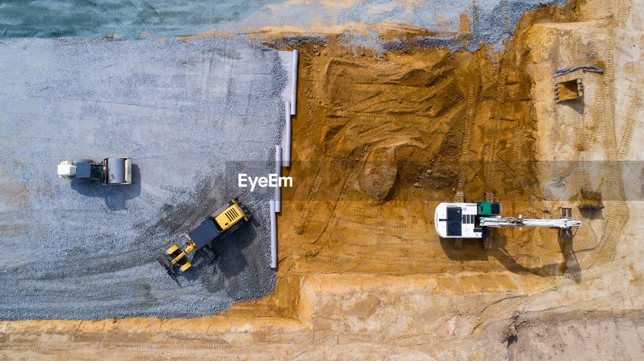 Directly Above Shot Of Construction Vehicles At Site