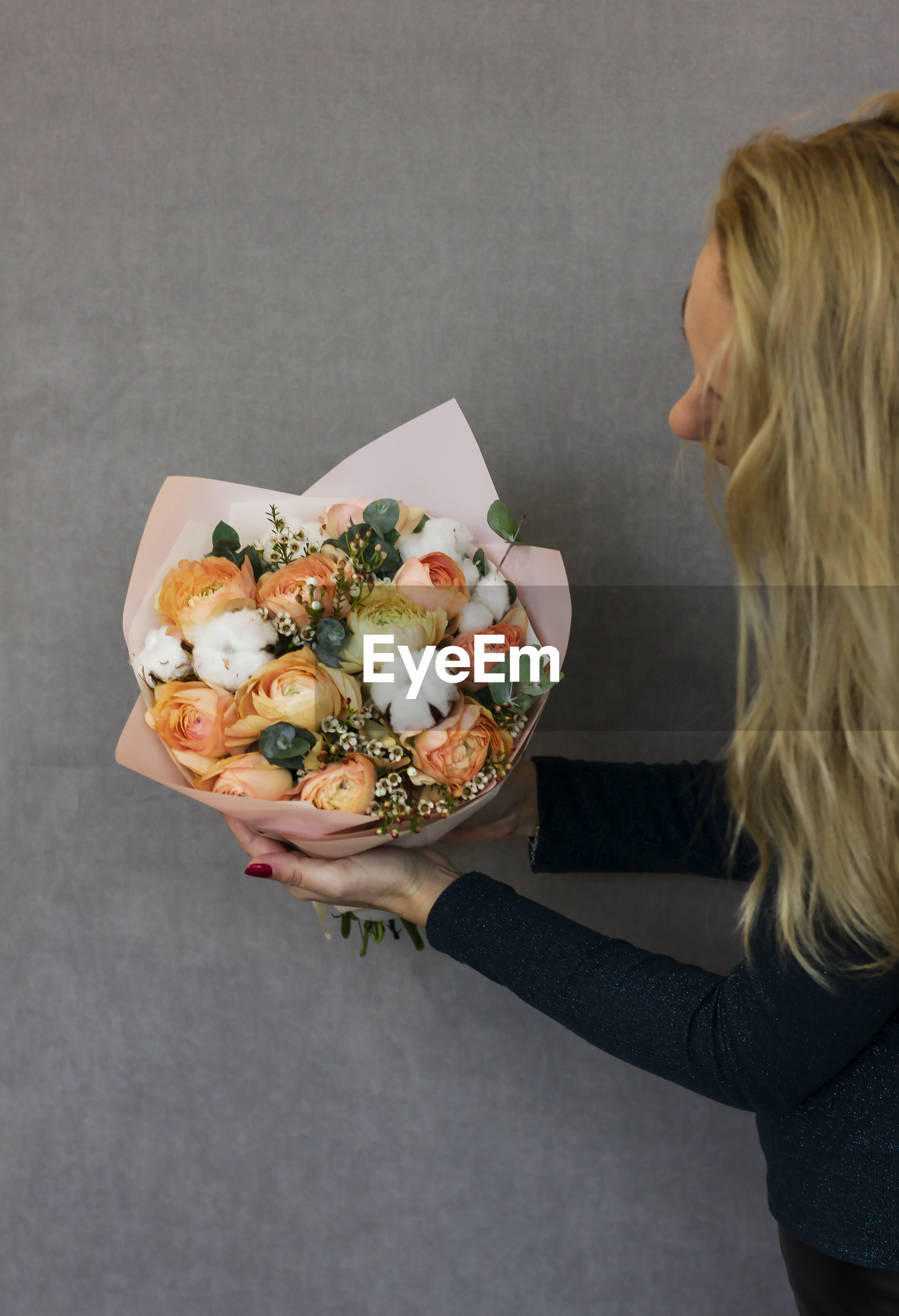 High angle view of woman holding flower bouquet