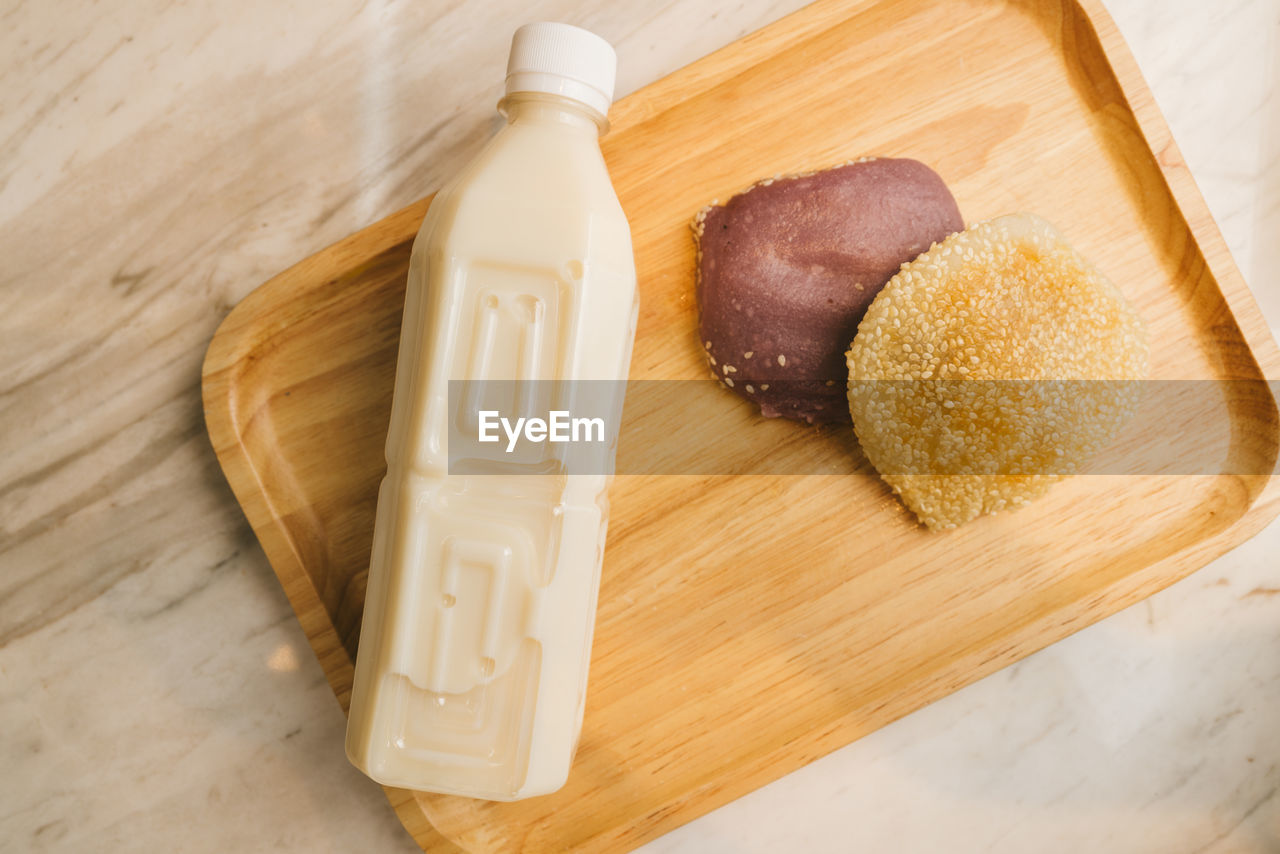 food and drink, food, table, wood - material, high angle view, freshness, still life, indoors, no people, indulgence, container, close-up, cutting board, unhealthy eating, ready-to-eat, sweet food, wellbeing, baked, brown, temptation, snack