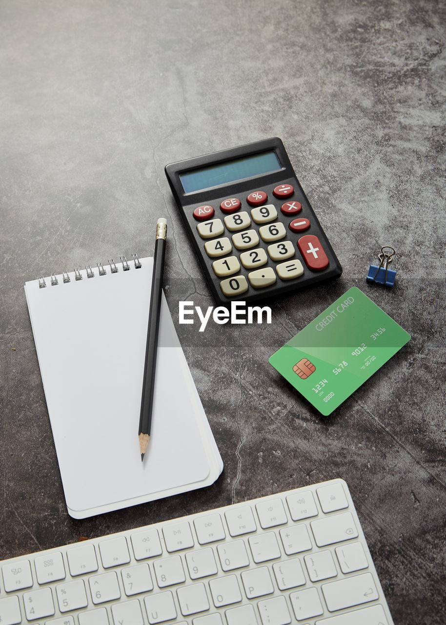 calculator, technology, number, communication, still life, business, indoors, table, computer, no people, connection, high angle view, close-up, finance, keyboard, computer keyboard, wireless technology, computer equipment, accuracy
