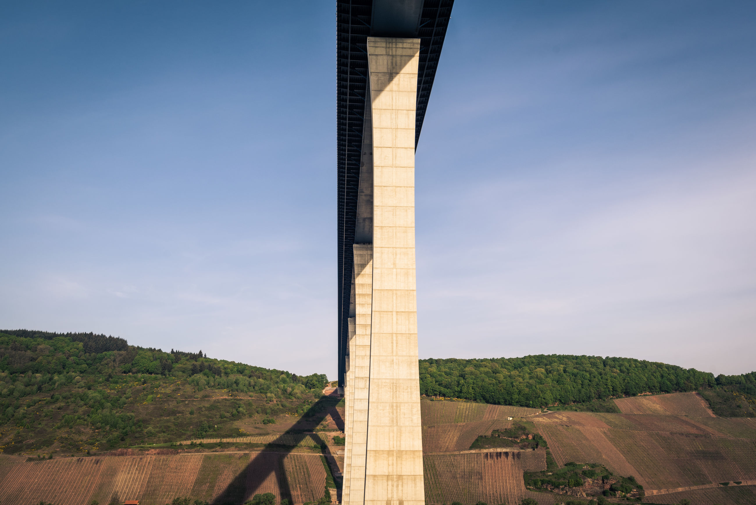 LOW ANGLE VIEW OF BRIDGE OVER LANDSCAPE AGAINST SKY