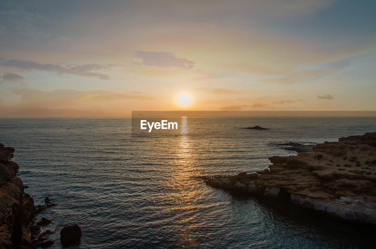 sky, water, sea, sunset, scenics - nature, beauty in nature, horizon over water, horizon, tranquility, tranquil scene, cloud - sky, beach, idyllic, land, sun, no people, non-urban scene, nature, orange color, outdoors