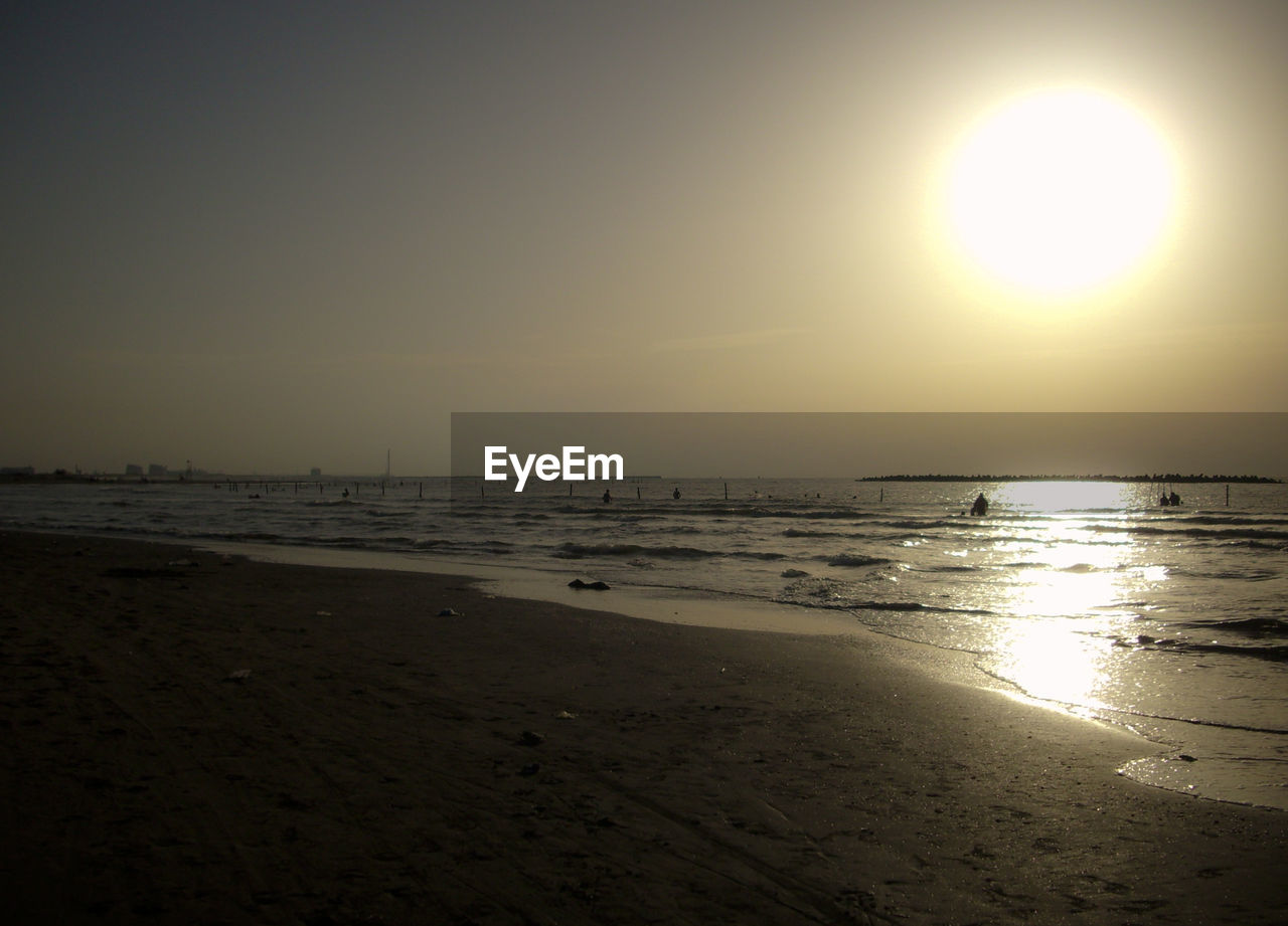sun, sunset, sea, beach, sand, shore, water, nature, beauty in nature, scenics, sunlight, bright, tranquility, sky, horizon over water, no people, outdoors, summer, clear sky