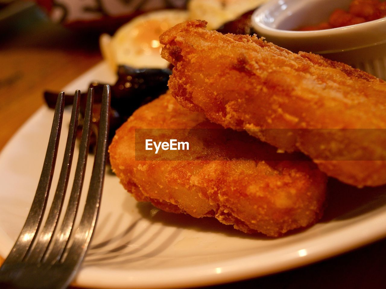 food, food and drink, plate, freshness, ready-to-eat, still life, fork, serving size, close-up, table, unhealthy eating, indoors, indulgence, fried, dip, appetizer, deep fried, snack, focus on foreground, no people, meat, condiment, side dish, sweet food, fried chicken, fast food