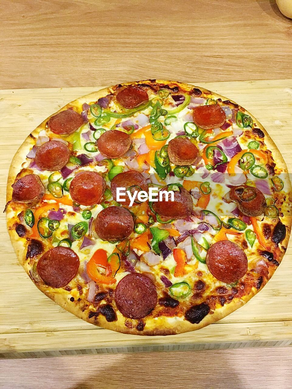 pizza, food and drink, food, table, freshness, unhealthy eating, ready-to-eat, still life, indoors, high angle view, wood - material, fast food, no people, olive, sausage, vegetable, dairy product, pepperoni, cheese, indulgence, temptation, pepperoni pizza, snack