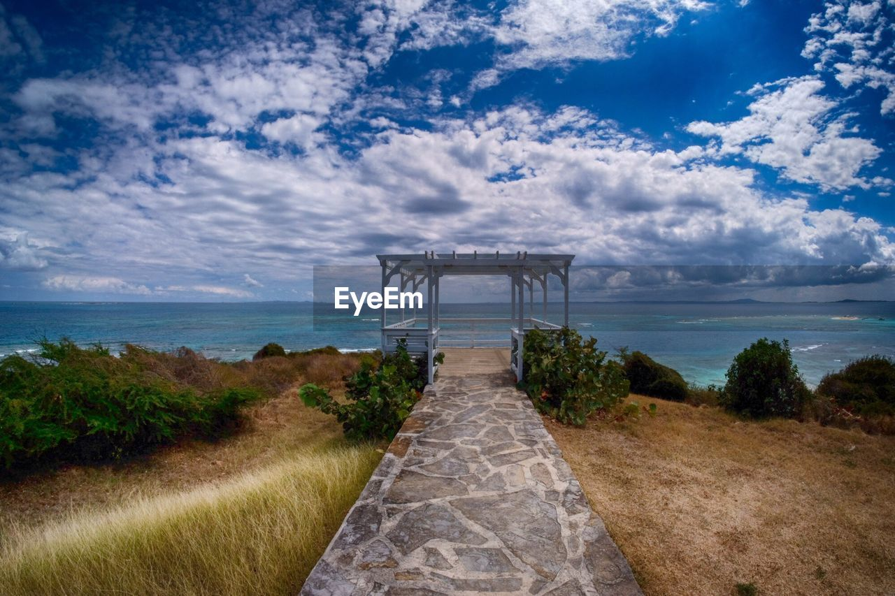 cloud - sky, sky, sea, water, nature, outdoors, scenics, day, horizon over water, tranquil scene, beauty in nature, no people, the way forward, tranquility, built structure, grass, tree, architecture