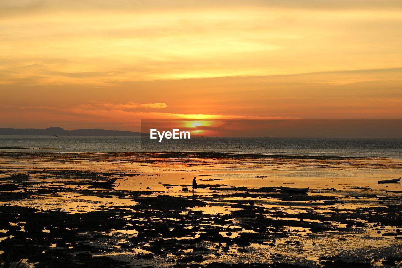sky, sunset, water, scenics - nature, sea, beauty in nature, tranquility, orange color, tranquil scene, land, horizon over water, idyllic, beach, cloud - sky, nature, horizon, no people, outdoors, remote