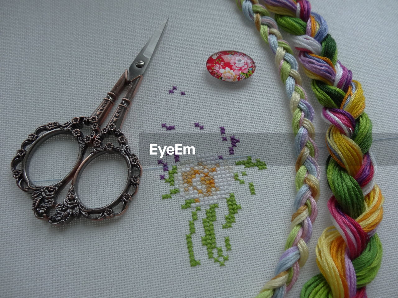 no people, indoors, close-up, still life, high angle view, table, creativity, art and craft, jewelry, directly above, necklace, thread, craft, wool, choice, pattern, variation, textile, flower, bead, personal accessory, purple