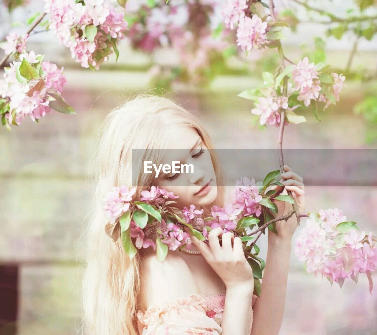 flower, young adult, pink color, one person, young women, blond hair, fragility, beautiful woman, freshness, blossom, real people, day, headshot, close-up, one young woman only, outdoors, nature, flower head, people