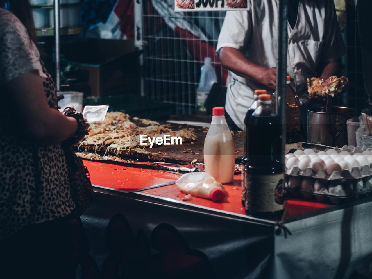 Food stall at summer festival matsuri at night in japan / small business