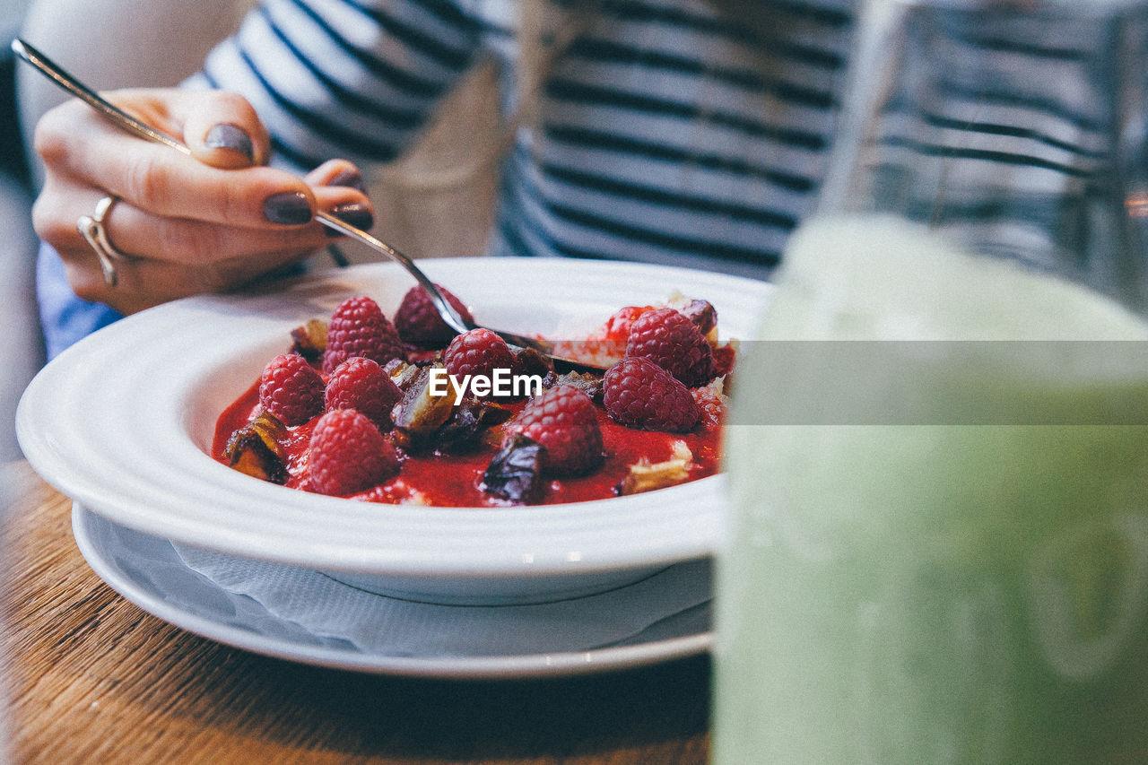 High Angle View Of Woman Eating Healthy Food