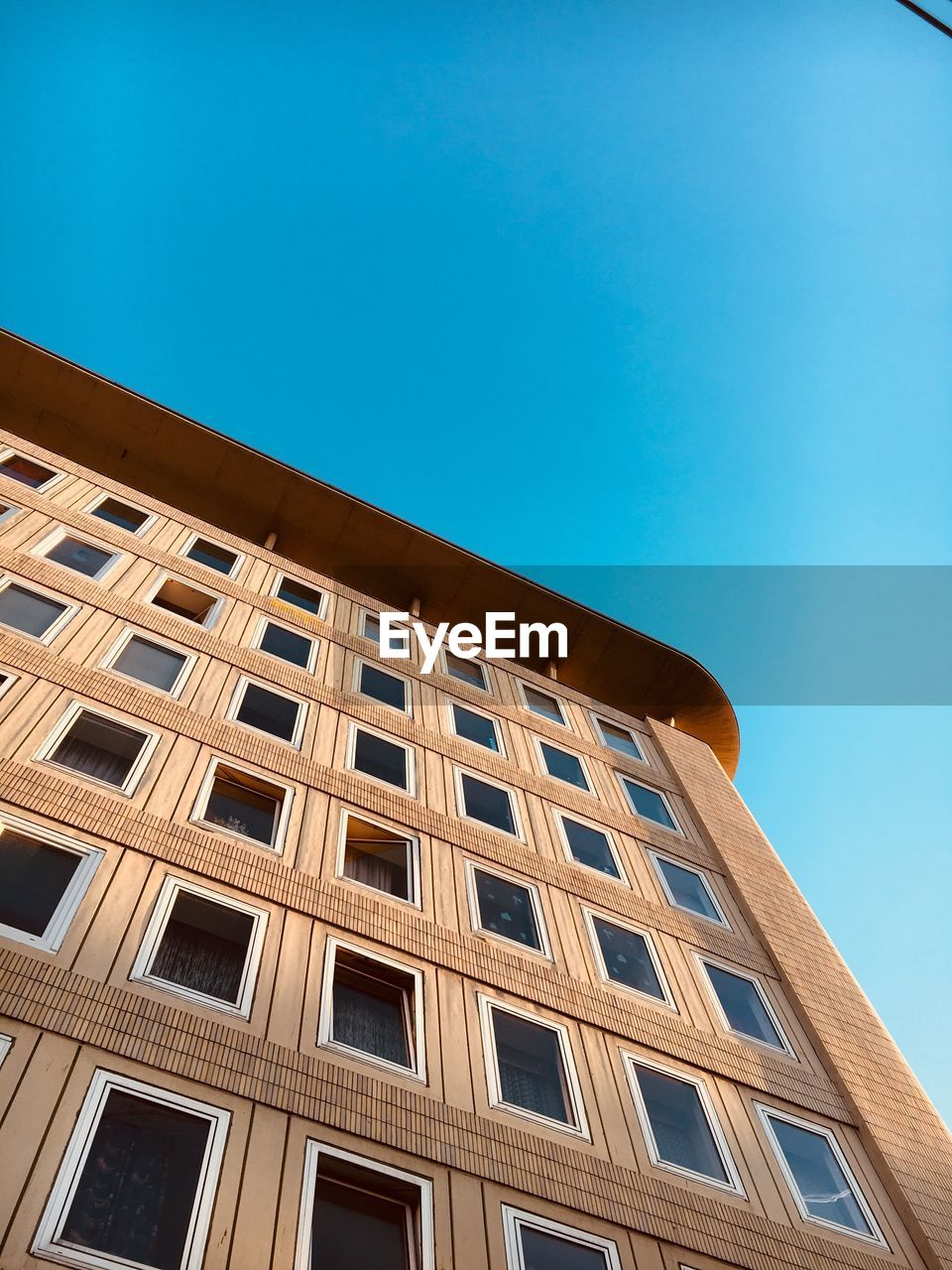low angle view, architecture, building exterior, built structure, blue, window, clear sky, day, outdoors, no people, sky