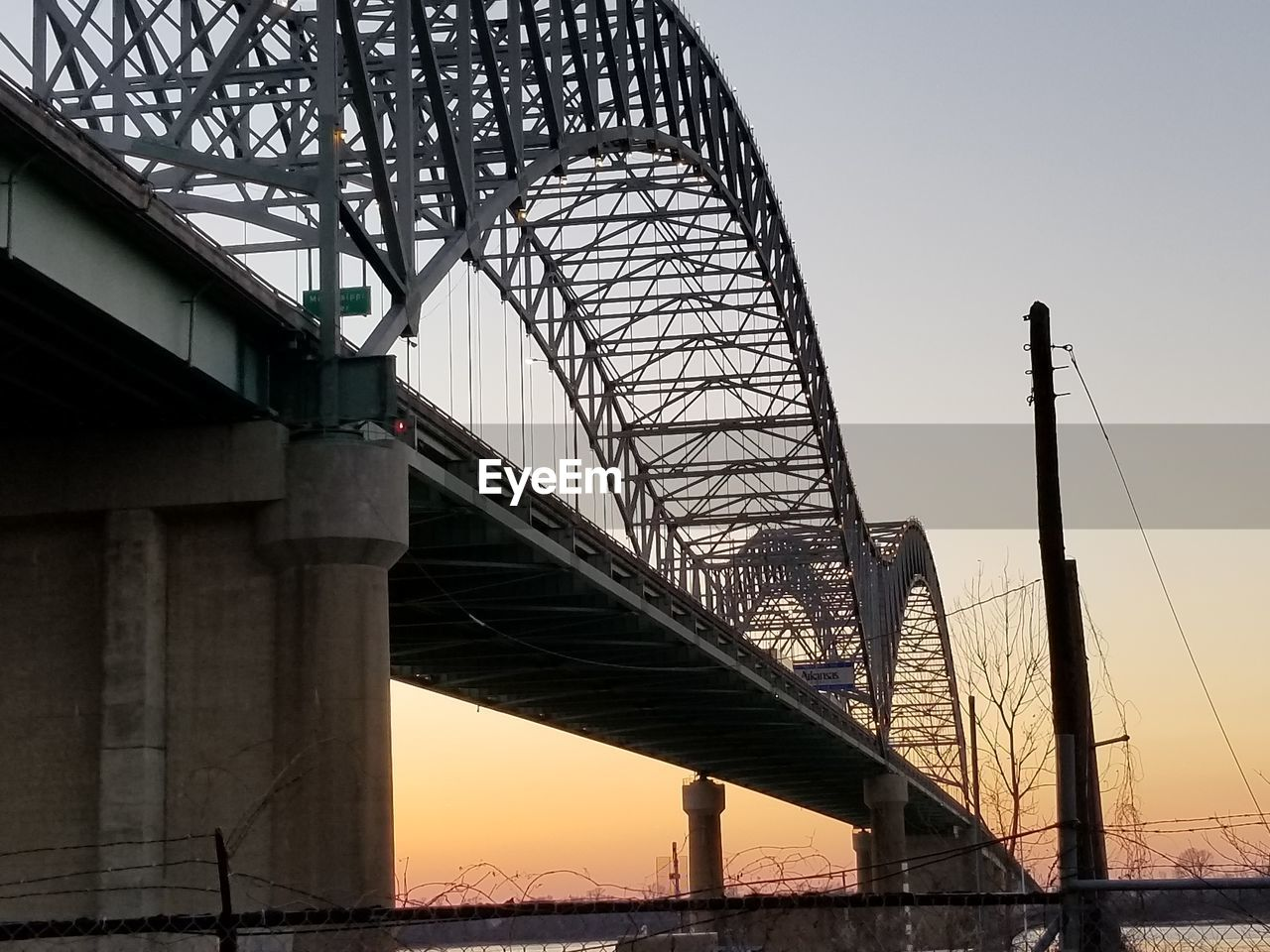architecture, built structure, sky, bridge, bridge - man made structure, connection, transportation, engineering, nature, low angle view, water, sunset, metal, travel destinations, outdoors, city, travel, architectural column, long