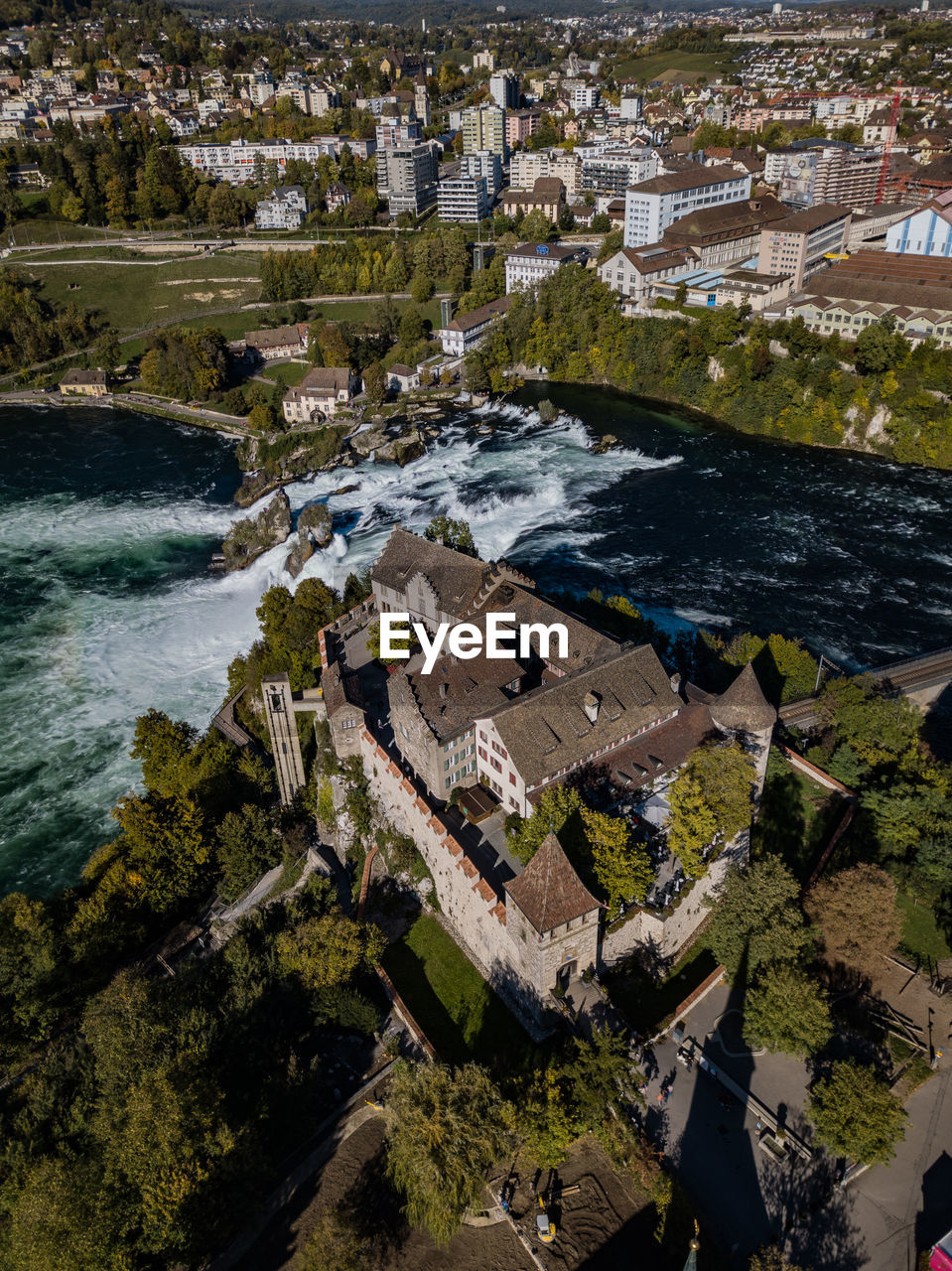 high angle view, aerial view, building exterior, water, river, built structure, architecture, outdoors, tree, no people, travel destinations, nature, day, cityscape, city
