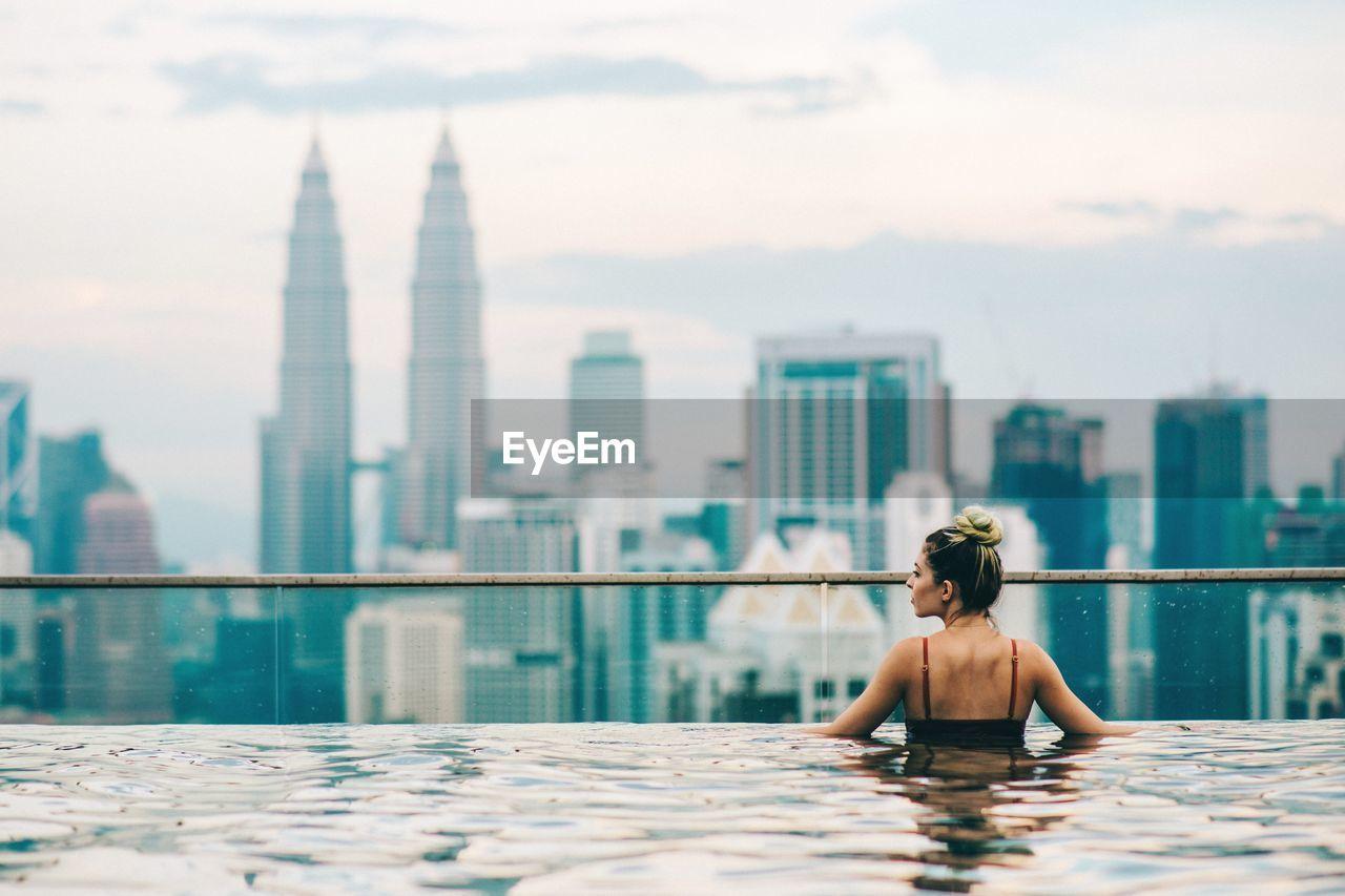 Woman relaxing in swimming pool