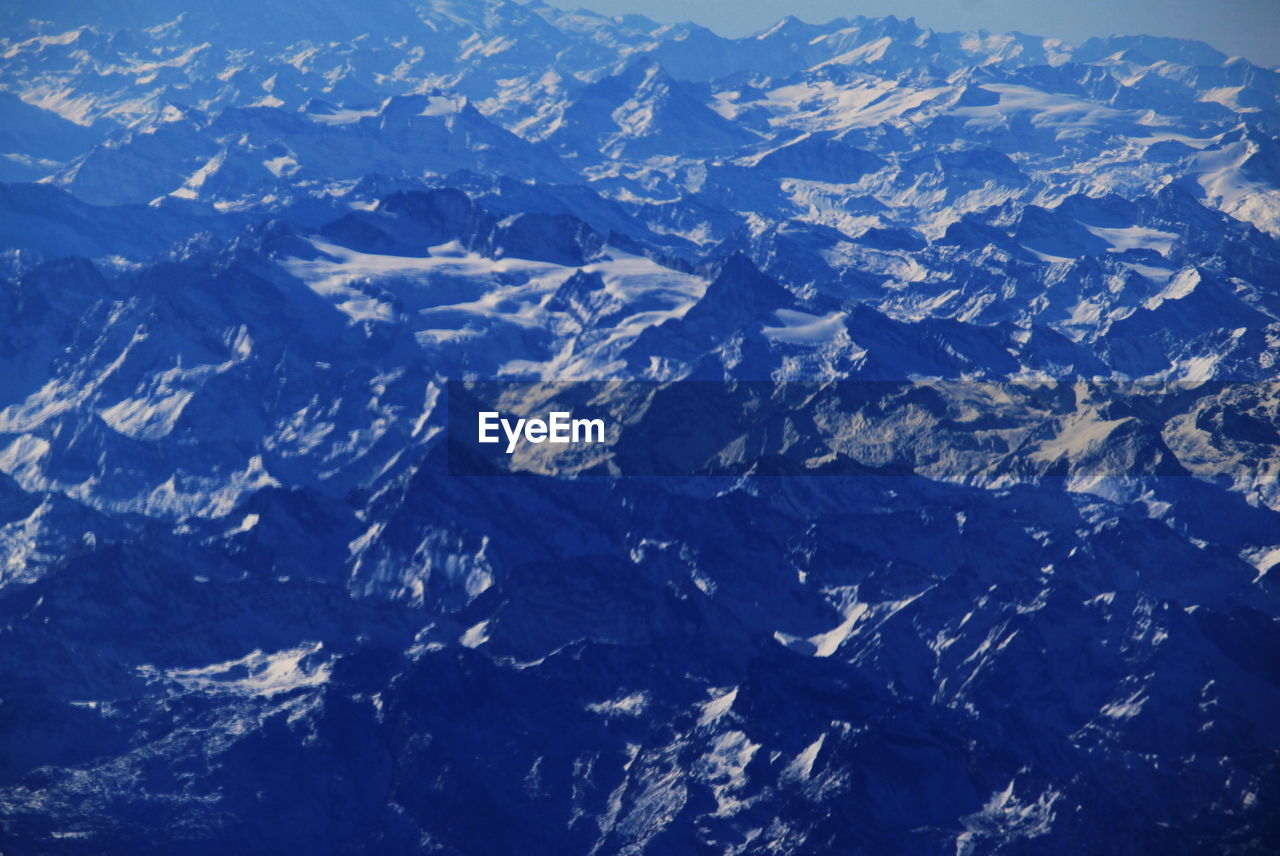 nature, geology, aerial view, mountain, landscape, scenics, beauty in nature, cold temperature, physical geography, snow, tranquil scene, day, mountain range, volcanic landscape, outdoors, tranquility, no people, winter, blue, view into land, close-up