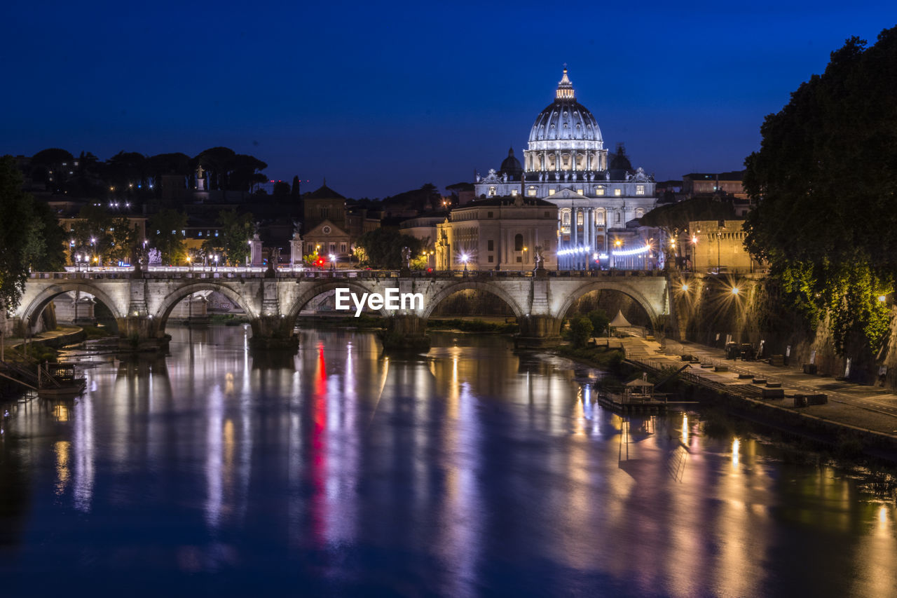 architecture, built structure, arch, building exterior, water, reflection, night, illuminated, bridge - man made structure, connection, history, outdoors, river, no people, travel destinations, sky, blue, city