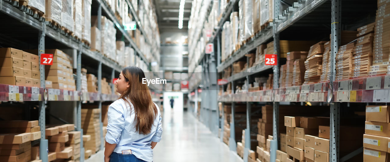 Rear view of woman at warehouse