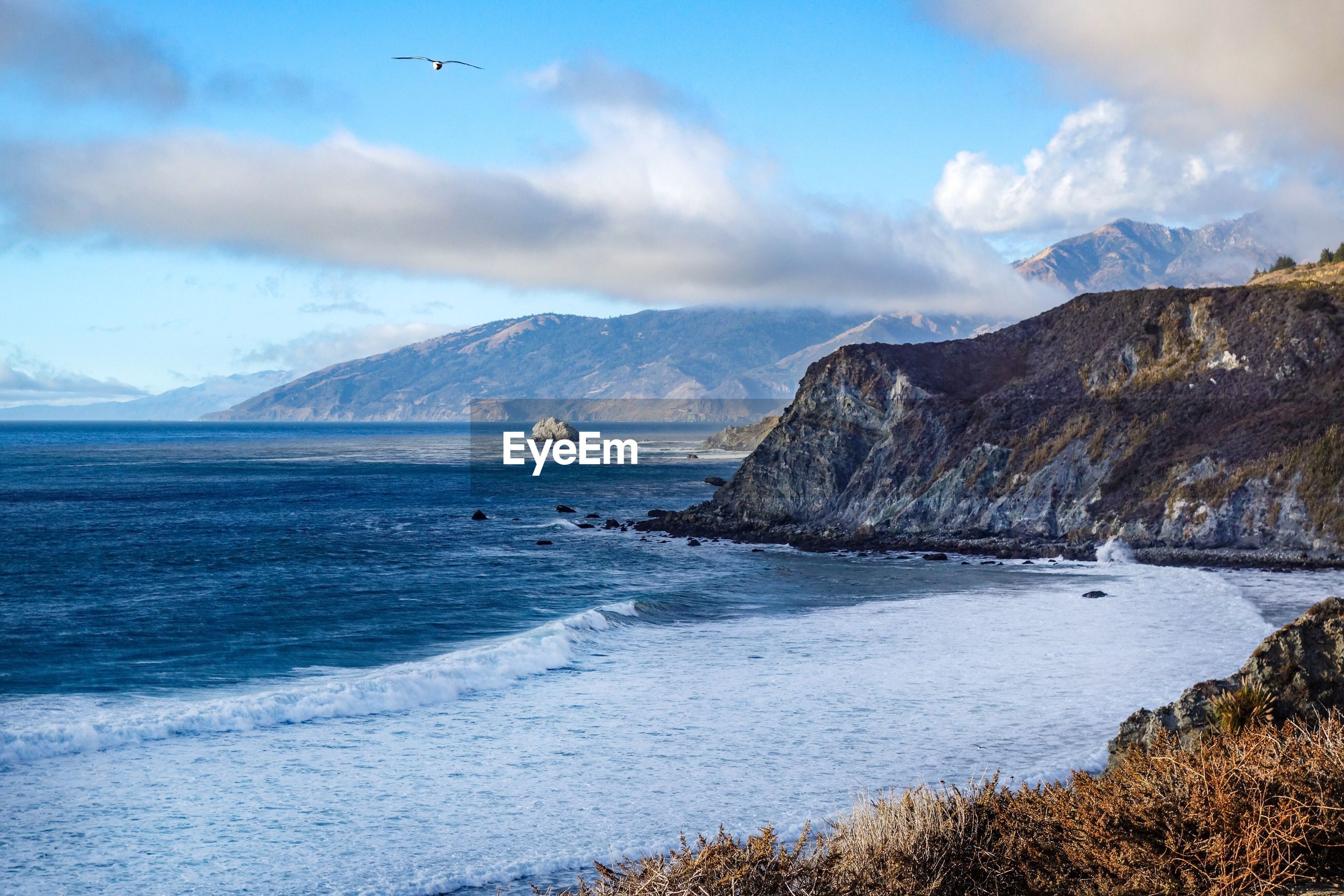 Scenic view of ocean and mountains