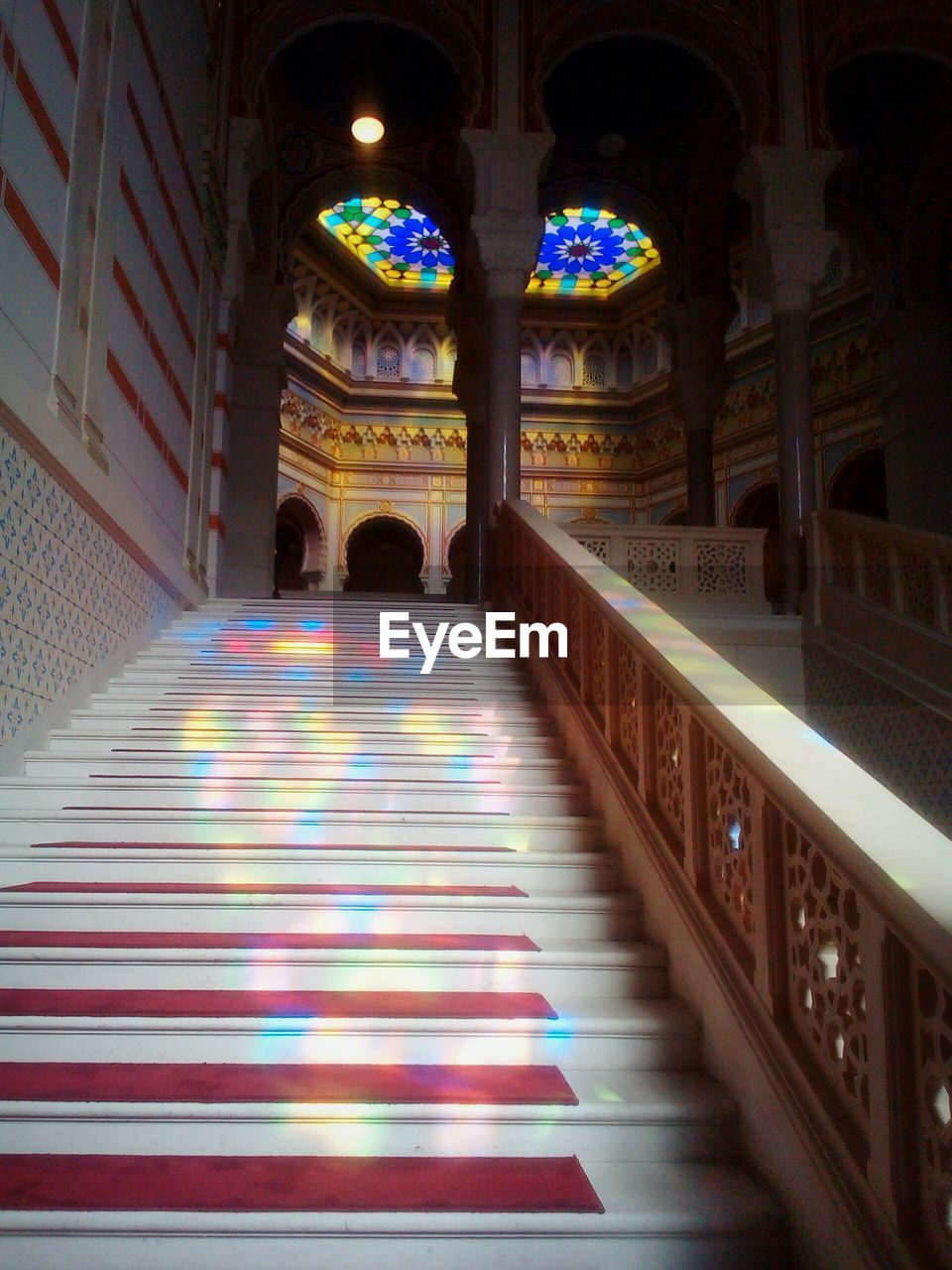 arch, illuminated, architecture, indoors, built structure, architectural column, spirituality, place of worship, multi colored, real people, day