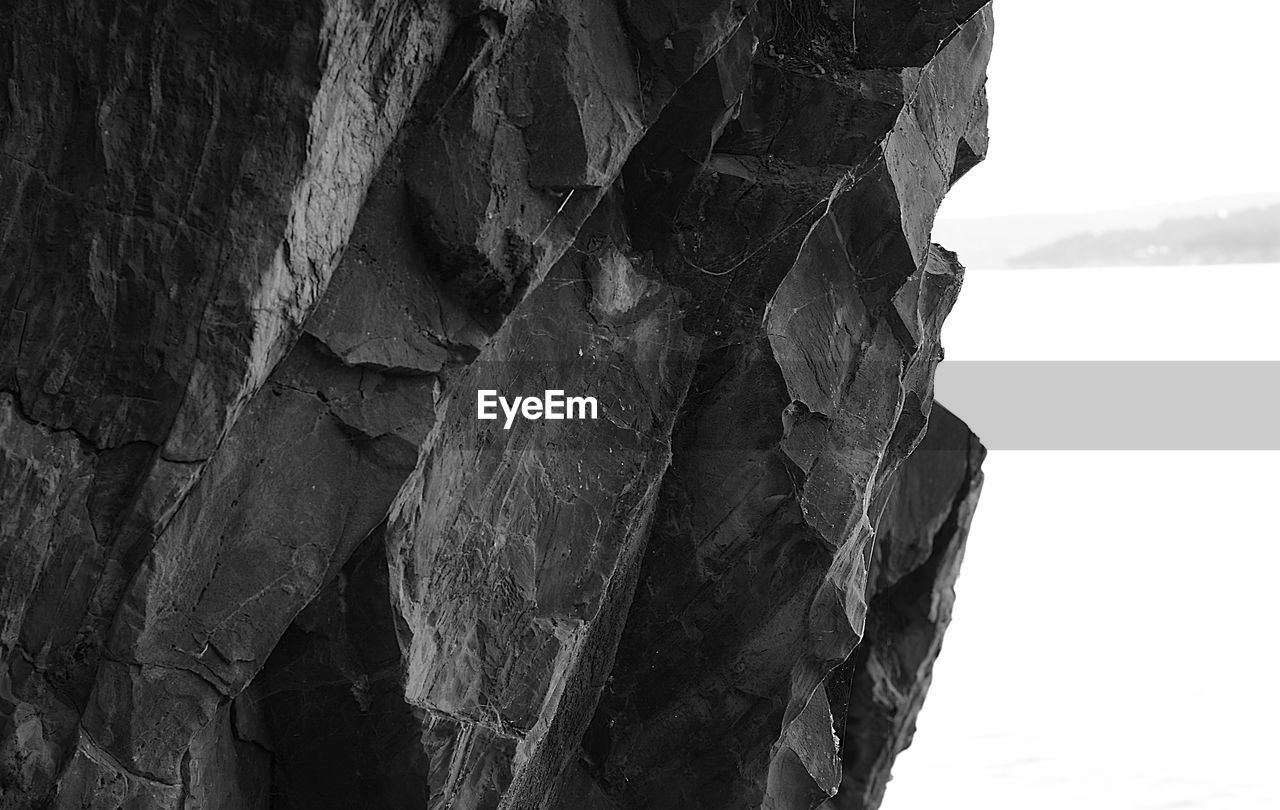 CLOSE-UP OF ROCK FORMATIONS IN A VALLEY
